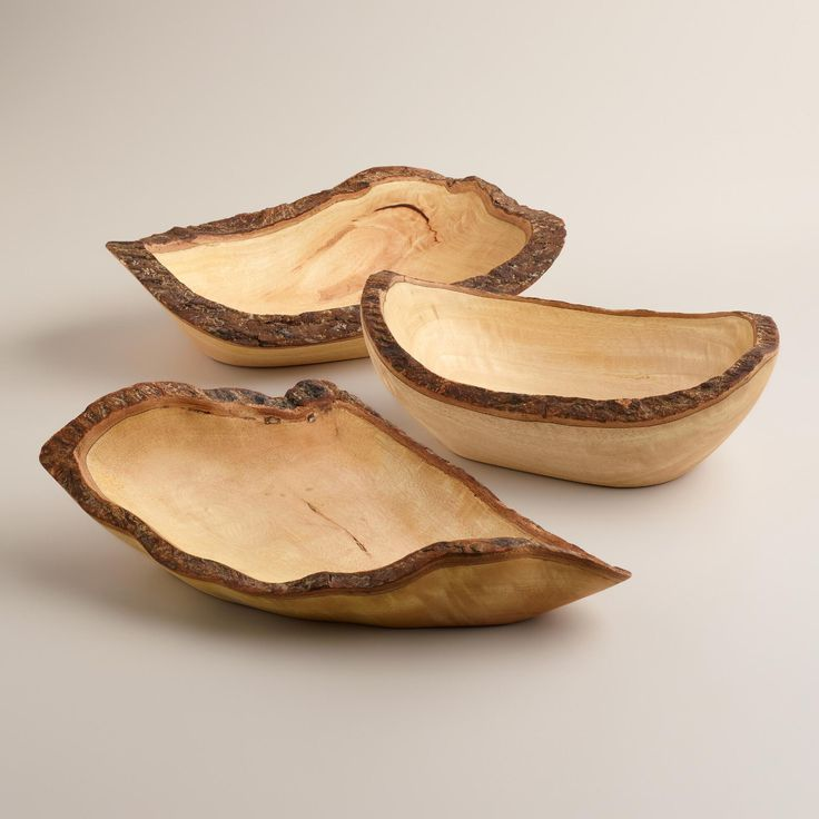 Discovered in Thailand, our incredible hand carved Wood Bark Bowl brings exotic looks to any setting at an amazing value. A sensational centerpiece at the dining table, especially when filled with a favorite side dish. The natural bark detail and exposed wood grain here is extra enticing! Available in three shapes - let us choose for you!