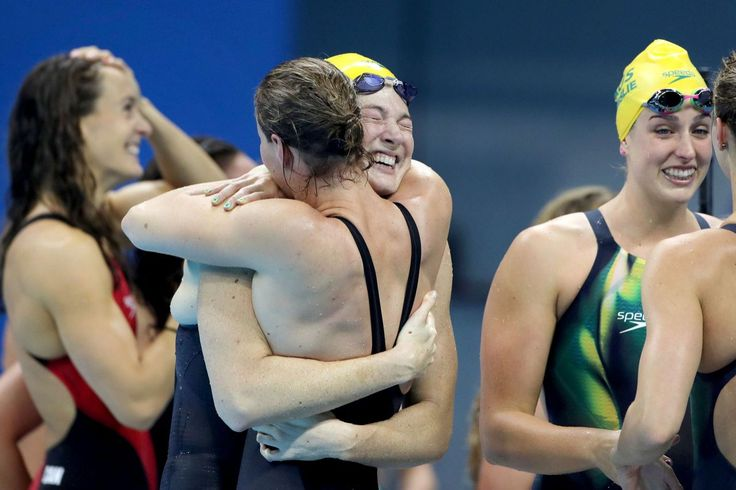 Bronte and Cate Campbell, Australia Sisters Bronte Campbell and Cate Campbell, (facing), hug after winning the gold medal in world record time along with team mates Emma McKeon and Brittany Elmslie, in the Women's 4 x 100m Freestyle Relay Final during the swimming competition at the Olympic Aquatics Stadium August 6, 2016 in Rio de Janeiro, Brazil