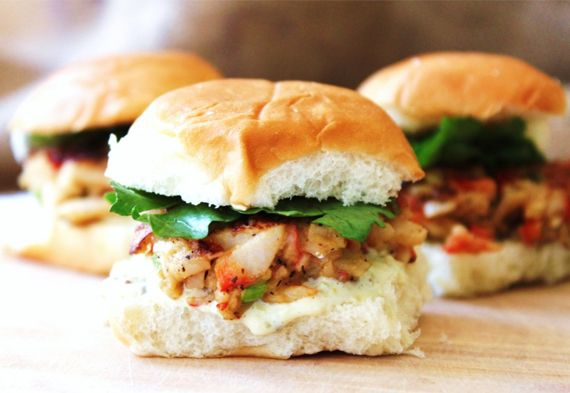 Crab Cake Sliders | The marriage of crab cakes and sliders is a natural one. One where the two won't be separated until digestion do them part. The size of a standard crab cake makes it suited for the tiny buns used in most sliders, and the tartar sauce makes for a solid condiment. White Castles in Maryland should consider selling these.