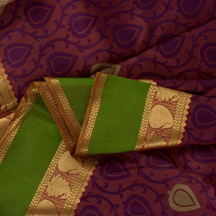 This charming #Kanjivaram silk #sari is a ravishing Sarangi creation! Beautifully woven rain drops in zari and purple jacquard weave, laid out amidst delicate vines, ornament the bewitching two toned purple and orange body. The honey brown pallu features a shimmering layer of zari gorgeously etched with classic paisleys and vanki #weaves. A band of green and red edged with zari paisleys border the sari on either side... 100122130