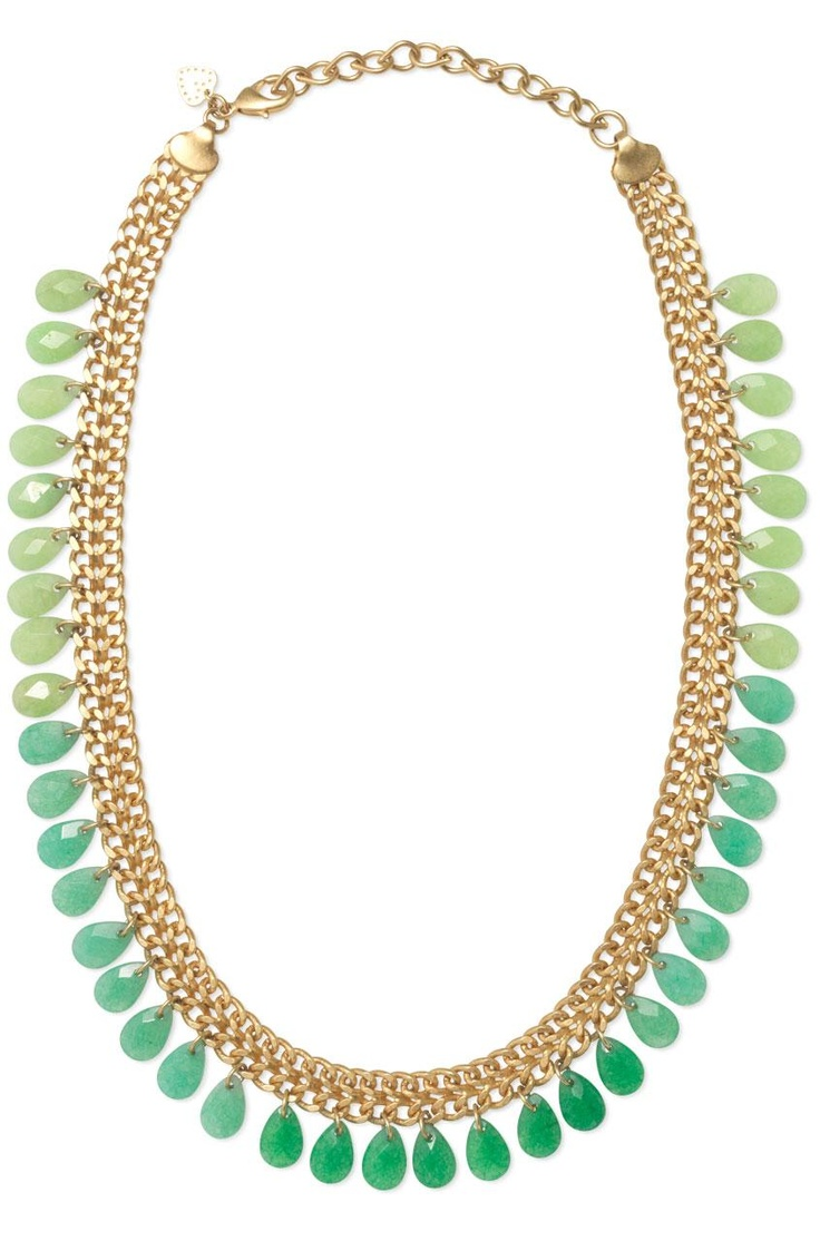 The Contessa Jade Necklace is a brass chain, with a worn gold finish, and it's fringed with hand cut jade stones in a beautiful gradient.  Love the beautiful greens.