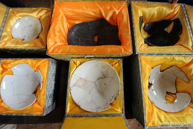 Photo taken on June 22, 2013 shows porcelains found at the archeological site of an ancient tomb in Fangshan District of Beijing,