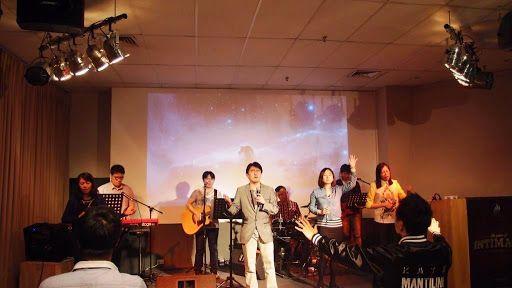 Pastor John Lee, senior pastor of CHC Sydney, ending the time of worship with prayer ...