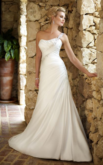 Style 5648 Graceful and glamorous, this designer sheath wedding gown is crafted with Satin Chiffon and features lovely Lace accents and a stunning beaded single-shoulder strap you can detach if you choose.