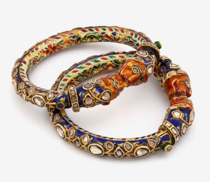 A MAGNIFICIENT PAIR OF DIAMOND 'KADAS' Set with table-cut 'polki diamonds, weighing approximately 35.00 carats in total, these 'kadas' or bangles have finials designed as stylized tiger's heads, and bear an intricate foliate design in green, red and orange enamel.