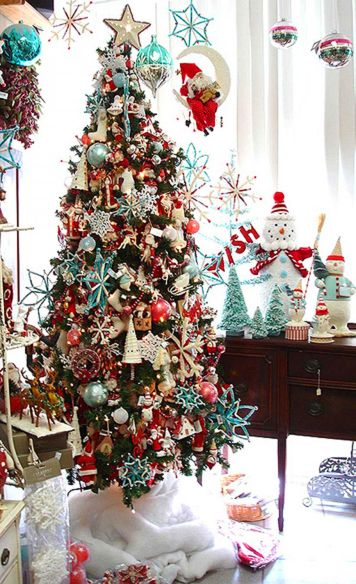 I LOVE how many ornaments are on this tree, but my 3 year olds would destroy it!  Maybe when they get older.