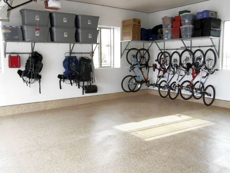 This undated photo courtesy of Monkey Bar Storage shows a garage organization system by Monkey Bar Storage. As the weather gets warmer and the spring cleaning urge hits, it's a good time to take stock of your garage.   (AP Photo/Monkey Bar Storage ) NO SALES