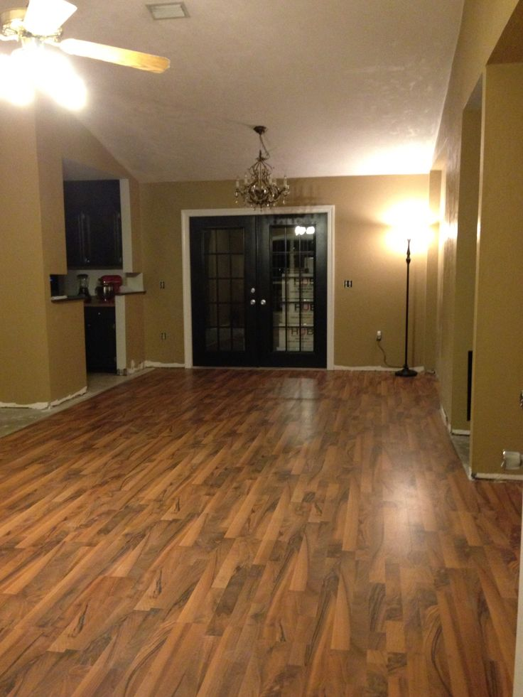 Laminate floor dark doors and trim along with brown walls for Inexpensive laminate flooring