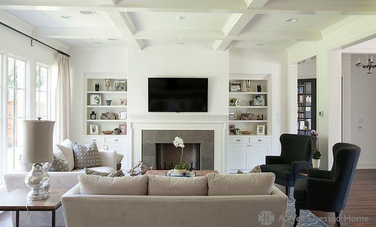 grey couch, white chair, black chair, grey rug, dark wood