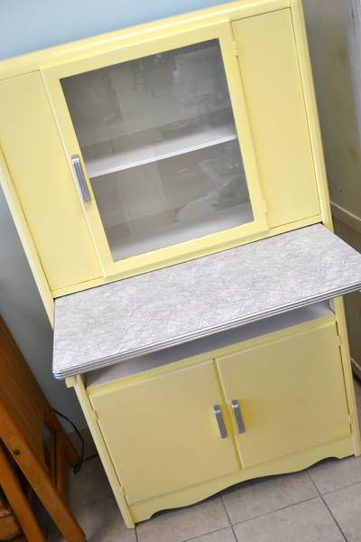 Vintage Hoosier Cabinet in a soft Butter Yellow