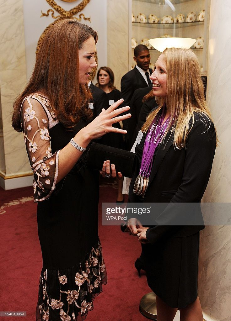Catherine, Duchess of Cambridge talks to paralympic swimmer Stephanie Millward (R) during a reception held for Team GB Olympic and Paralympic London 2012 medalists at Buckingham Palace on October 23, 2012 in London, England.  (Photo by John Stillwell - WPA Pool/Getty Images)