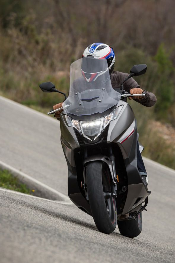 The Honda Integra may look scooter-shaped, but don't be fooled! Underneath the scooter-shaped façade is an engine and chassis shared with the NC750X. Click the photo to read our full review and first ride of the Honda Integra 2016. #Motorcycle #Motorbike #BikeReview #FirstRide #RideYourOwnRide #Rider #BikeRide #Honda #Ride #ThePowerOfDreams #HondaReview #HondaIntegra #HondaIntegraReview