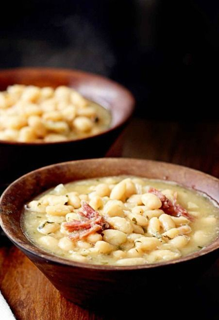 White Bean and Ham Hock Soup | Fill up with this deliciously hearty soup made with white beans, sliced ham hock, and savory chicken broth. It's a protein-packed dinner recipe that doesn't fall short in flavor.