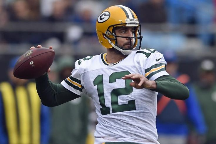 FILE - In this Dec. 17, 2017, file photo, Green Bay Packers' Aaron Rodgers looks to pass against the Carolina Panthers during the first half of an NFL football game in Charlotte, N.C. Rodgers wants to follow Tom Brady's path and still chuck it when he's in his 40s. He also accepts that in today's NFL he might again follow Brett Favre's footsteps and one day don something other than the green and gold.  (AP Photo/Mike McCarn, File)