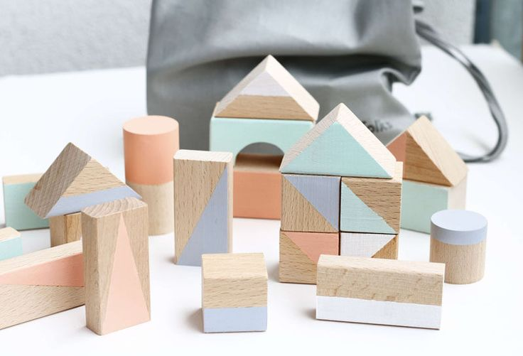 10 Key Features Of Scandinavian Interior Design // Simple Toys -- Wooden toys and tents made from dowels and fabric fill Scandinavian style playrooms.
