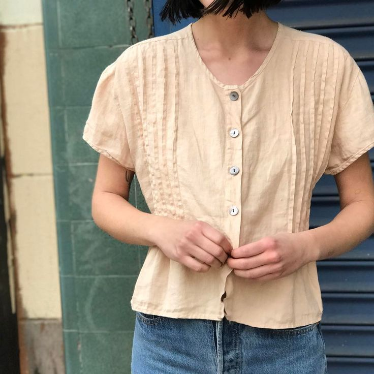 Vintage peach linen button down. Will fit Sz Sm-Md. $32 + shipping. First to comment with postal code for invoice. SOLD