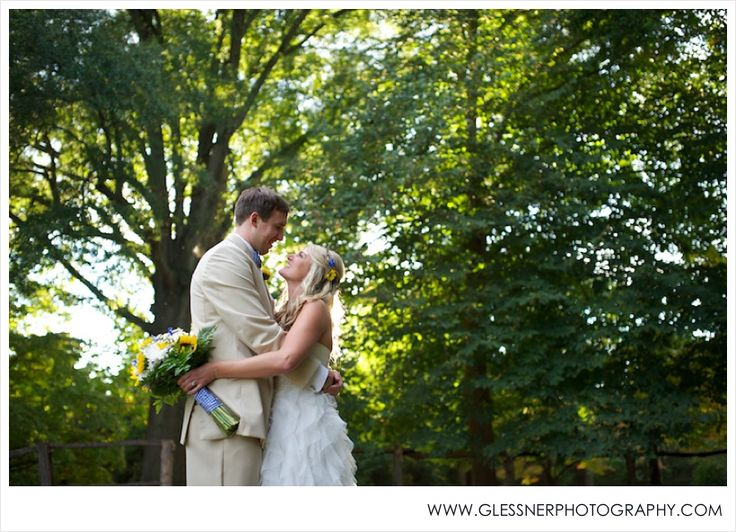 Becky+Ryan's beautiful Southern soiree at Old Salem in Winston-Salem, NC | Images ©2013 Glessner Photography | Khaki Groom's Suit | Flowers in Hair | Sunflowers | Gingham