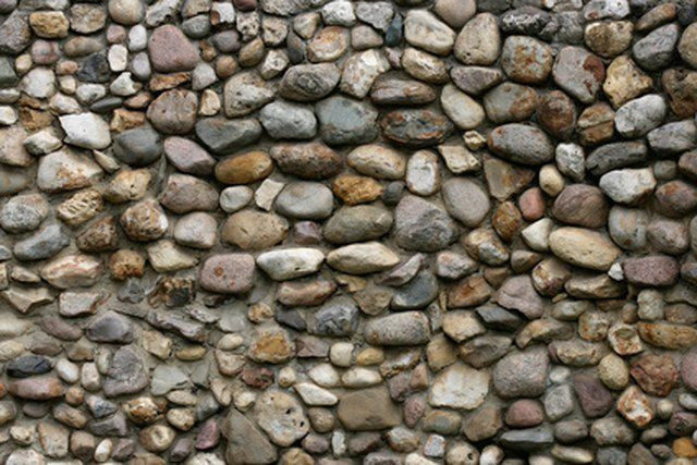 How To Build A Stone Wall With Round Stones Cement Hunker Building A Stone Wall Stone Walls Interior Stone Wall
