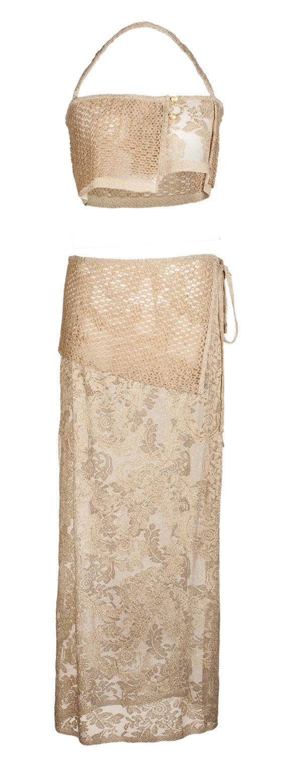 Gold stretch lace pareo-skirt and top with natural jute applications.  A simple right line for pareo-skirt that can be tied on your side. Short natural juta sash. Adjustable top from 42 to 48 size .  Entirely handmade in Italy.