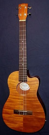 My Korala Koa Cutaway Electrio-Acoustic Baritone at Ukulele Corner --- https://www.pinterest.com/lardyfatboy/