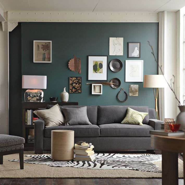 interesting wall items, love the lamp, table... comfy room... west elm.