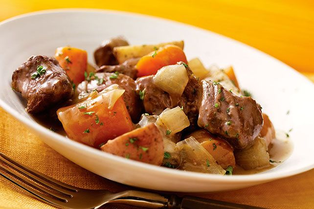 Coming home to the savory aroma of our hearty beef and veggie slow-cooker stew, you might want to do a happy dance. Go ahead. It's better for you, too.