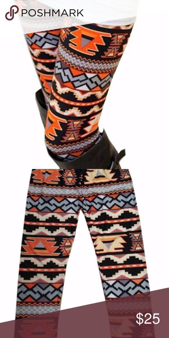 NEW 2017 orange Aztec print leggings NWOT boutique stretchy orange Aztec print leggings. Comfortable and trendy. Pants Leggings