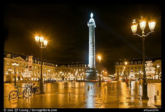 Place Vendome glistening at night. Paris, France (color)