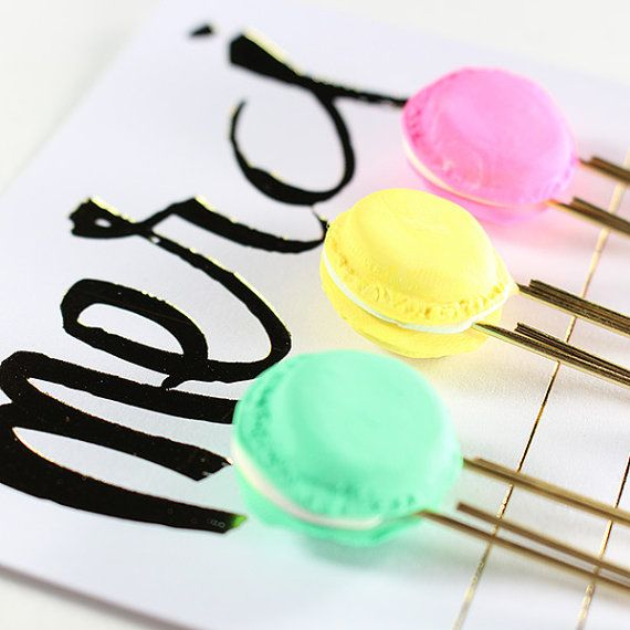 These adorable french macaron paper clips are made with polymer clay. They were made with the paper clip secure inside with adhesive prior to