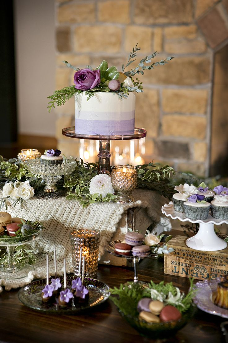 Purple ombre wedding cake and dessert table.