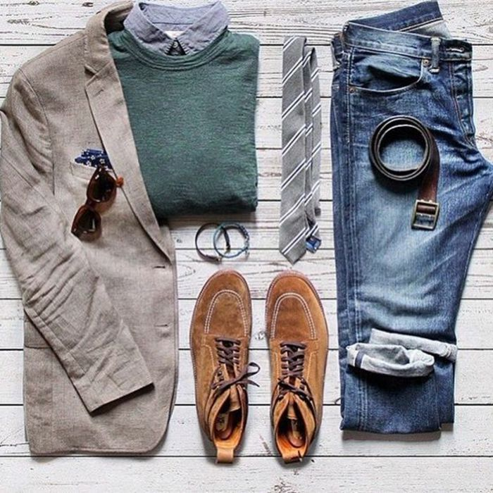 business casual outfits, grayish-brown man's blazer with sunglasses and handkerchief, over pale denim shirt folded inside a folded green sweater, a pair of brown leather lace up shoes, next to belt placed on folded jeans, necktie and bracelets