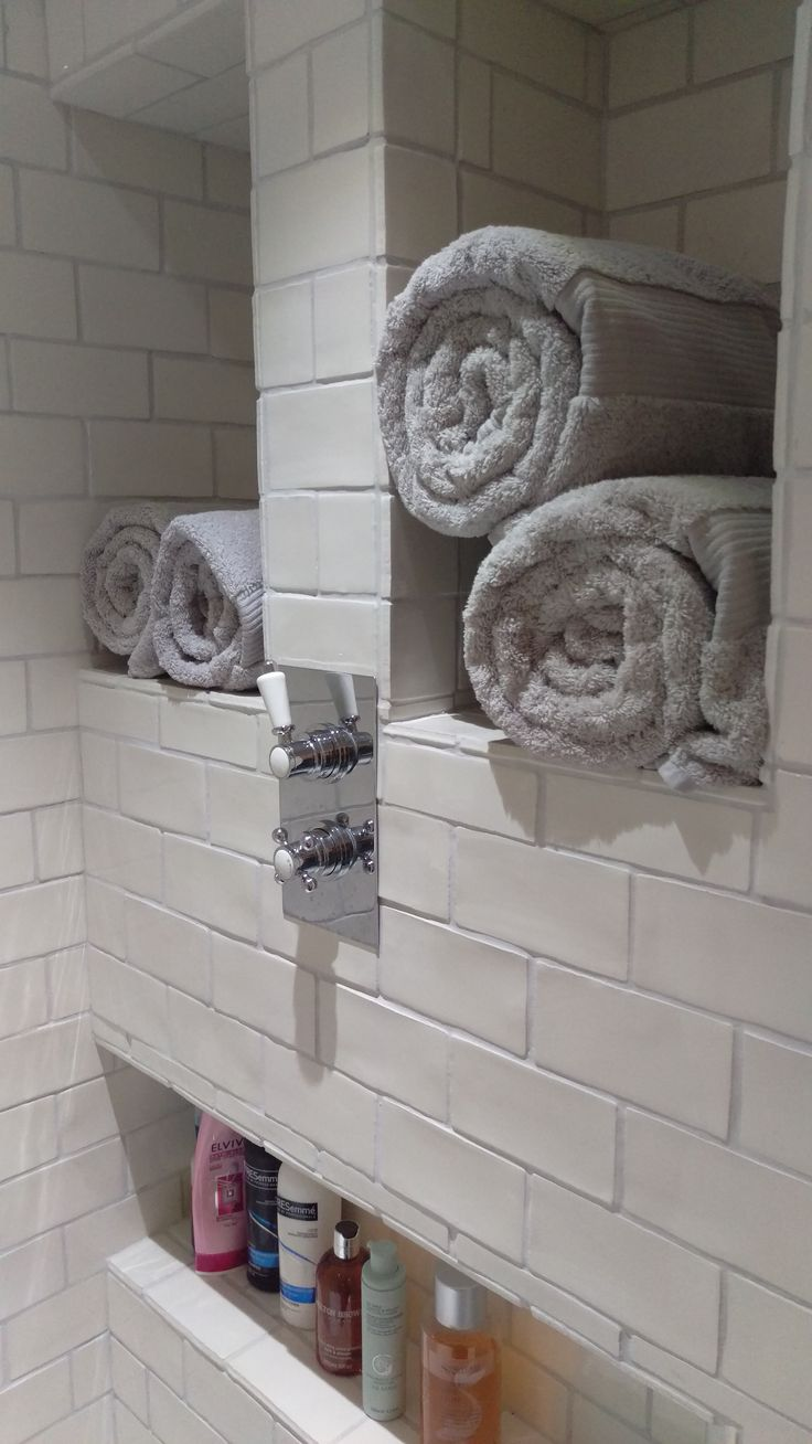 Recessed shelves in the shower enclosure provide space for towels and shower products.  Tiles from Malborough tiles - chosen because of the uneven edges of these hand made tiles give them a more traditional look, and because I needed the tiles to have a glazed side edge for the recessed shelves.