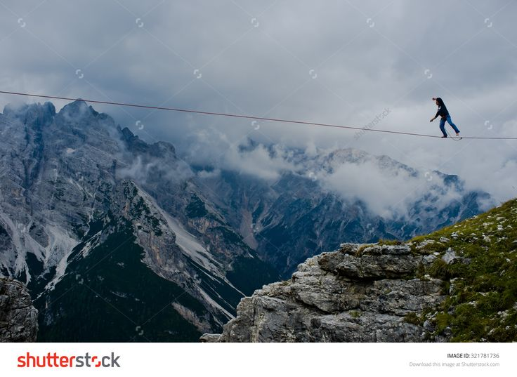 """Monte Piana, Dolomites/Italy - September 08, 2013: An Acrobat On A Rope Tended Above An Abyss During """"Highline Meeting"""" Of Tightrope Walkers From Around The World Taking Place Every Year On September Stock Photo 321781736 : Shutterstock"""