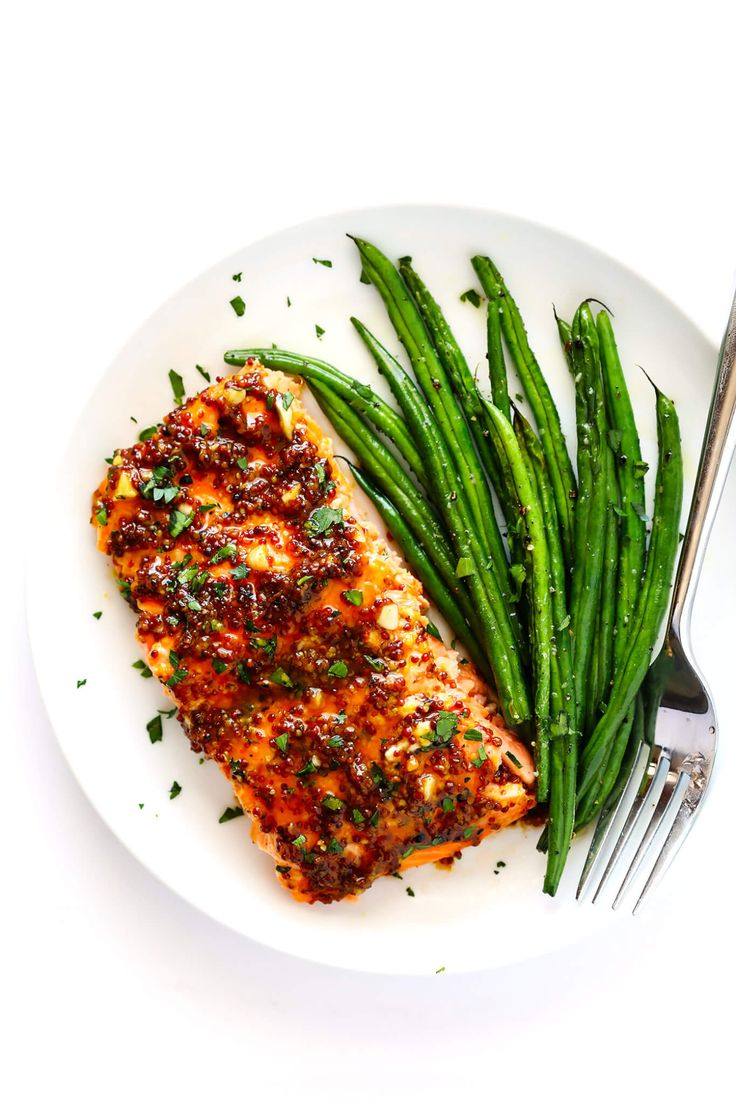 My favorite Honey-Mustard Salmon recipe!! It's made with an easy sauce full of whole grain mustard, honey, lemon juice, garlic and seasonings, and it's easy to bake in the oven or grill!   gimmesomeoven.com (Gluten-Free / Pescetarian)