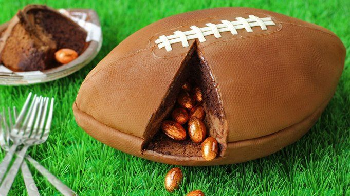 A realistic looking football-shaped cake filled with chocolate footballs. Perfect for your football or tailgating parties.