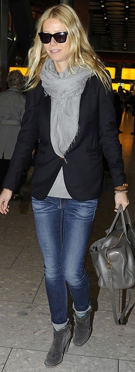 Who made Gwyneth Paltrow's black sunglasses, blue skinny jeans, and gray leather handbag that she wore in London on November 29, 2012?