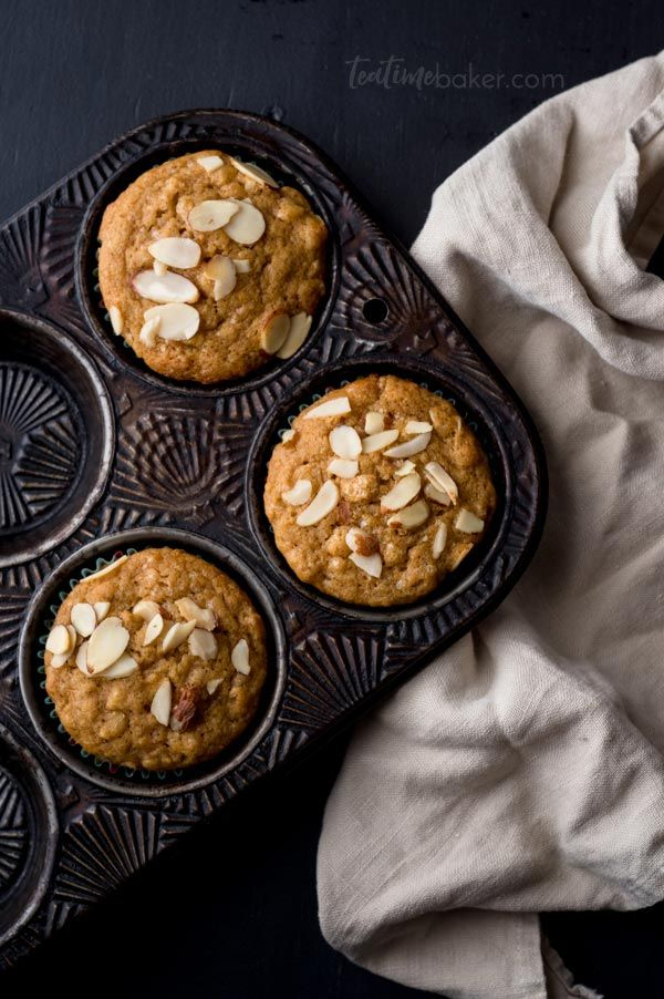 Start your day with a healthy muffin and hot tea. Packed with yogurt, pureed oranges, and oatmeal these muffins are soft and delicious with a citrus tang. | Healthy Breakfast | The Teatime Baker | Easy Muffin Recipe | #freshorangeoatmealmuffins #healthymuffinrecipe