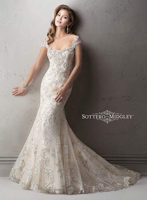 Sottero and Midgley: Ettiene. Exquisite beaded embroidered lace on tulle drapes over delustered satin in this fit and flare gown featuring dazzling Swarovski crystals on the neckline and shoulder straps. Complete with scoop neckline and finished with crystal button and zipper over inner corset closure. Optional detachable, cold shoulder cap-sleeves.
