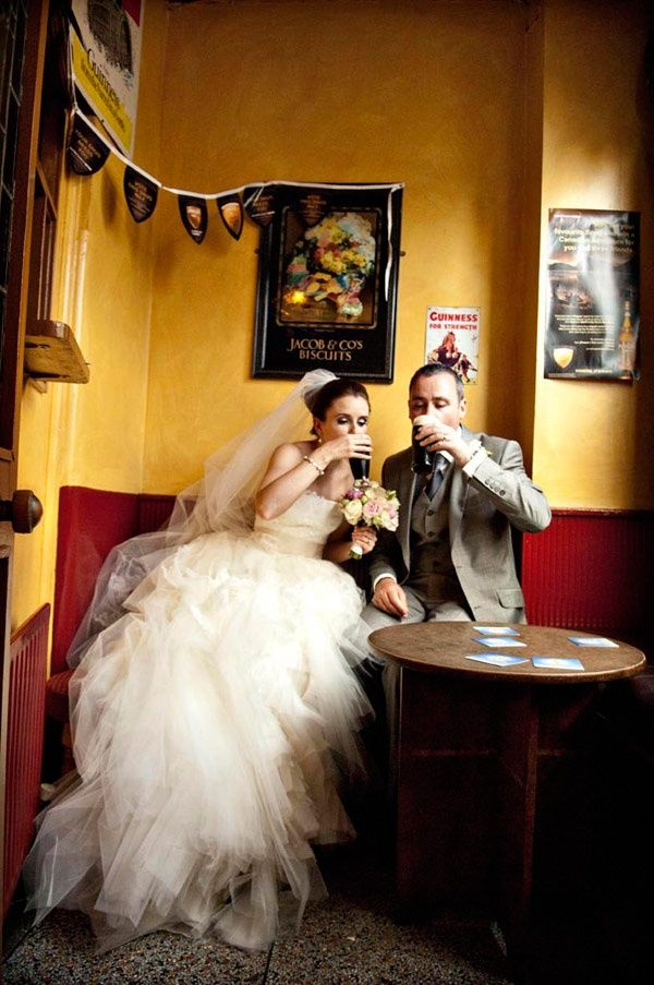 Irish Wedding Photo of a newlywed Irish couple with their first -- or maybe second ;) -- married pint.