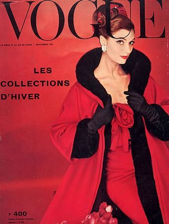 September 1957   Wearing a fur lined coat and evening dress by Dior, cover photo by William Klein