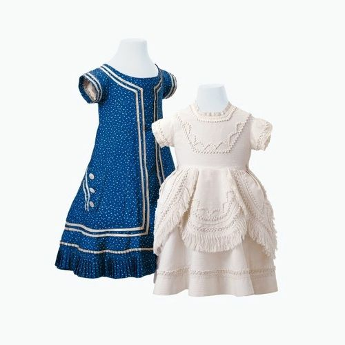 Girls' white cotton and blue silk dresses, circa 1880. Courtesy of the Historisches Museum Basel.