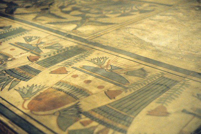 The painted floor of Akhenaten's palace, at Akhetaten, illustrates bouquets of water lilies and flower vases. Cairo Museum.