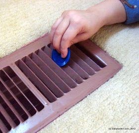 Child-proofing the air vents by putting tulle underneath to catch anything that a child might drop in there