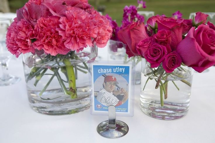 Flowers in vases with baseball cards