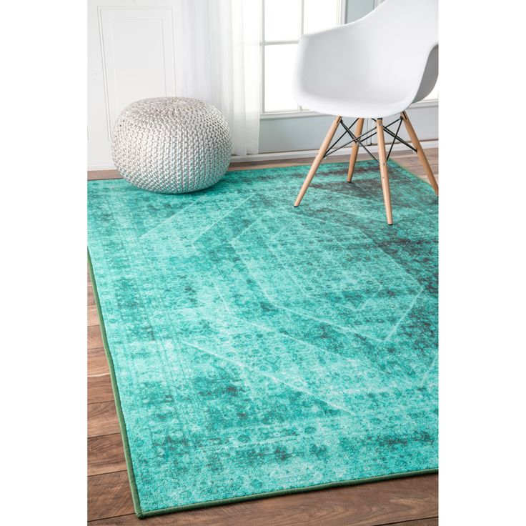 The unique overdyed traditional design of this rug will add color and flair to your home. The synthetic fiber makes it durable enough to place in high-traffic areas. The moderate pile height provides