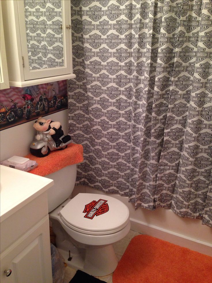 Harley Davidson bathroom make over. Decal on seat was free, well not totally free. Cut from a shopping bag and modge podged on toilet seat! Dang, just thought something...with more bags I could of used as a border on the wall