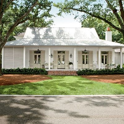 metal roof, one story, front porch, functional shutters. love