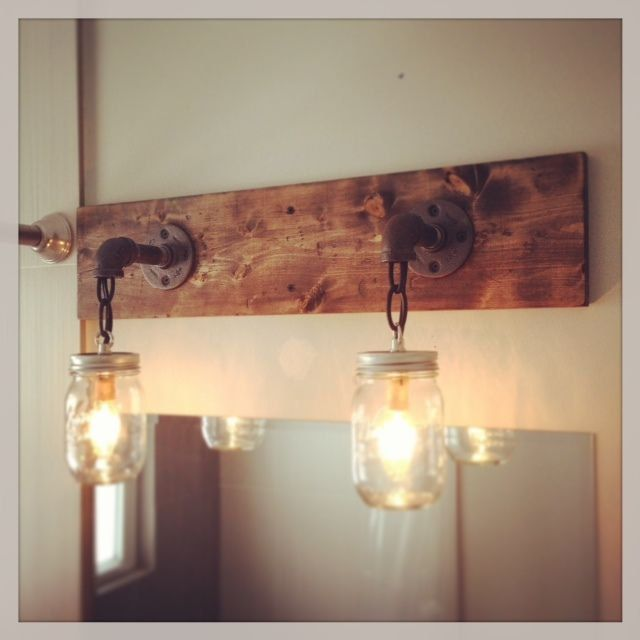 Industrial/Rustic/Modern Mason Jar Handmade Light Fixture  This industrial, rustic, modern, one of a kind light fixture will take you back to simple, practical things. The neat light fixture idea will make everyone stop, stare and wonder!  This sale is for a 2 mason jars light fixture.   Overview: *Handmade item, unused. The item may have slightly color variation than it is in a photo. *Materials-mason jar, wood, steel pipe, wire, chain *Candelabra base socket. Light bulb not included. *Made…