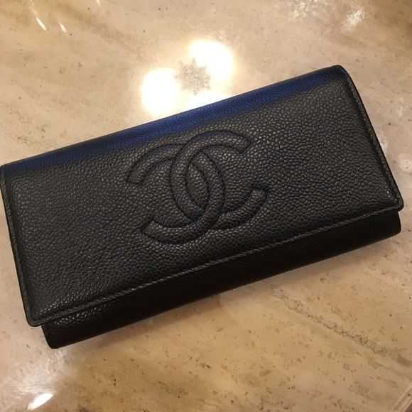 CHANEL Black Leather Flap Wallet Black leather flap Chanel wallet. 4 pockets, Zip coin pocket, 6 card holders. Brand new never used. No tags. Comes with box CHANEL Bags Wallets