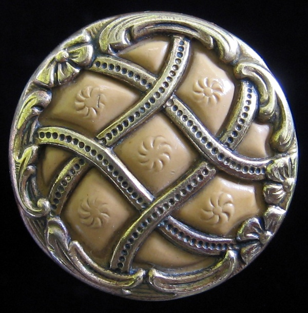 Antique brass and celluloid button